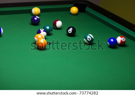 Billiard game balls against a green