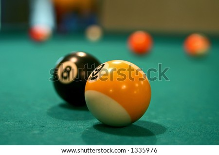 Billiard number nine ball close-up on the billiard table with small DOF