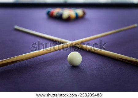Billiard table with balls arranged in a triangle