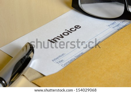 Billing invoice in the envelope on the table. - stock photo