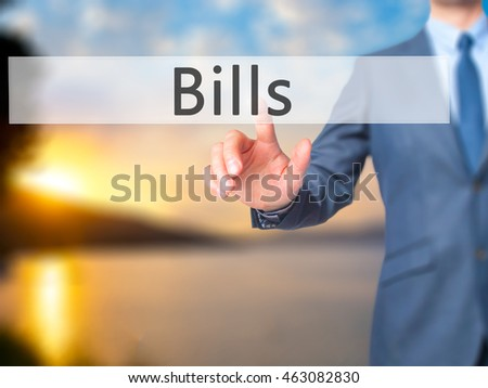 Bills - Businessman hand touch  button on virtual  screen interface. Business, technology concept. Stock Photo