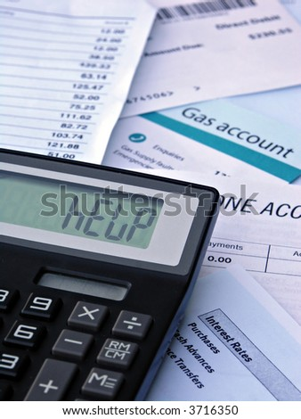 "Bills & Calculator displaying ""HELP"" - stock photo"