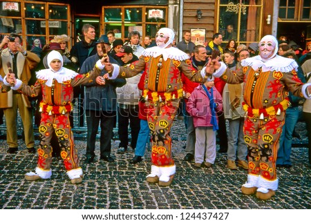 BINCHE, BELGIUM - FEBRUARY 24: Gilles in mask performs dance at Carnaval de Binche on February 24, 2004 in Binche, Belgium. Carnival in Binche is included in a list of intangible heritage by UNESCO