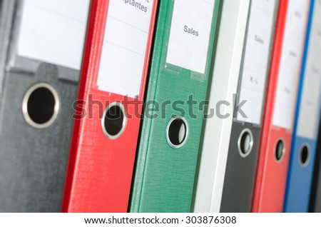 Binders in a shelf - stock photo