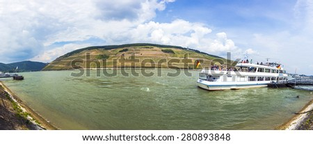 BINGEN, GERMANY - MAY 24, 2015: passenger ship on pier in Bingen, Germany. The rhine valley in Bingen is the most famous place visited by tourists at river Rhine. - stock photo