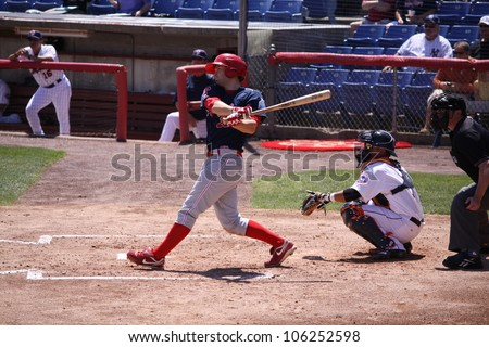 BINGHAMTON, NY - JUNE 14: Reading Phillies Tim Kennelly takes a big swing during a game against the  Binghamton Mets at NYSEG Stadium on June 14, 2012 in Binghamton, NY - stock photo