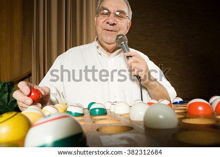 Bingo caller at work - stock photo