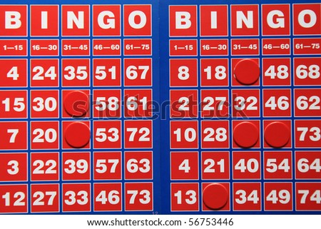 Bingo Cards with game pieces background - stock photo