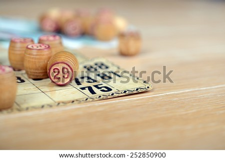 bingo (lotto) kegs and cards with rubles on the wooden table. Retro, vintage. - stock photo