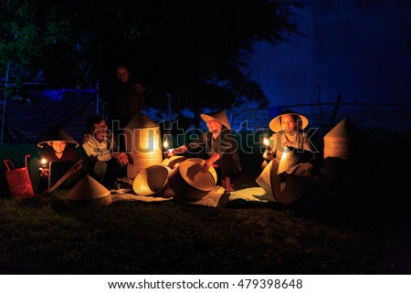 Binh Dinh Province, Vietnam - August 27, 2016: the image of a small market in the village with particular goods: specially buy traditional conical hats which are made from the craftsmen in the early