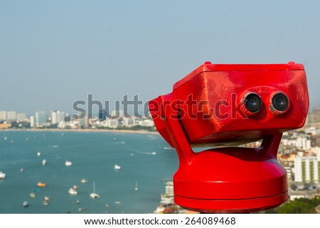 Binocular next to the waterside promenade looking out to the Bay - stock photo