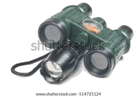 binoculars and flashlight on the white background