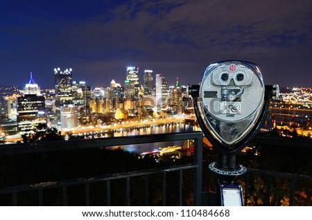 Binoculars for viewing the Pittsburgh, Pennsylvania skyline. - stock photo