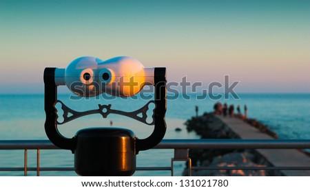 Binoculars on the sea of Grado, Sunset, Gorizia, Italy - stock photo
