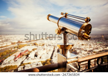 binoculars telescope and view on Paris