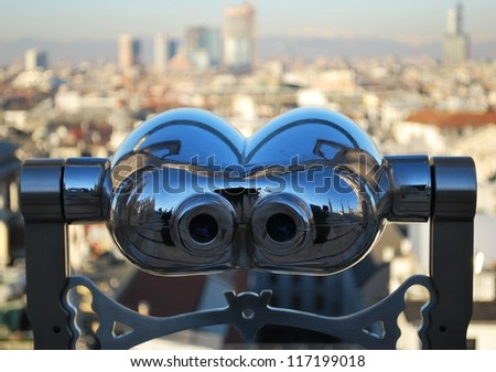 Binoculars telescope looking Milan panorama from the roof of the Duomo cathedral, Lombardy, Italy - stock photo