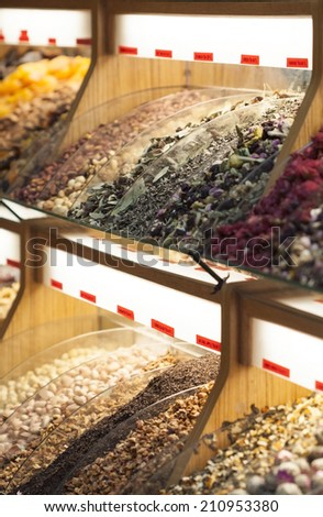 Bins of tea and spices in market - stock photo