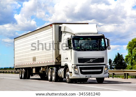 BIO-BIO, CHILE - NOVEMBER 23, 2015: Semi-trailer truck Volvo FH12.480 at the interurban freeway. - stock photo