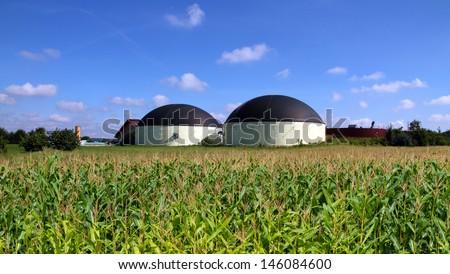 Bio gas plant in a maize field  - stock photo