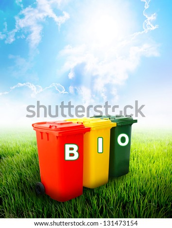 Bio wording on colorful recycle bins ecology concept with landscape background.