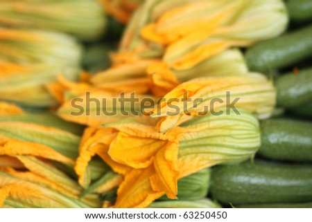 bio zucchini flowers at the farmers market - stock photo