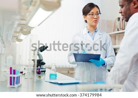 Biochemists in lab - stock photo