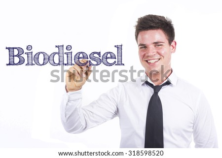 Biodiesel - Young smiling businessman writing on transparent surface - stock photo
