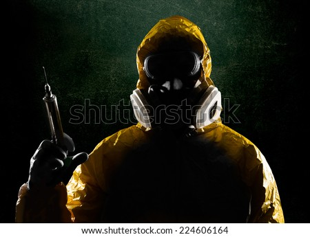 Biohazard Suit and large syringe  - stock photo