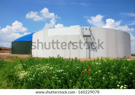 Biomass energy plant construction site with silo - stock photo