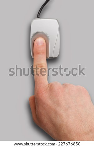 Biometrics - finger on a fingerprint scanner - stock photo