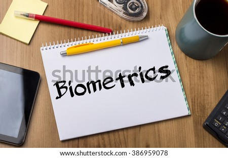 Biometrics - Note Pad With Text On Wooden Table - with office  tools - stock photo