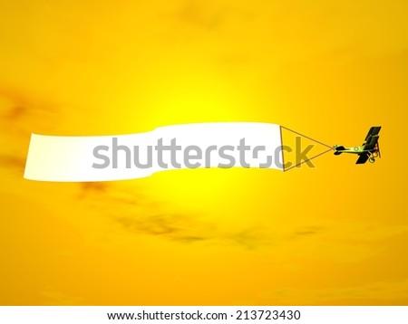 Biplane aircraft pulling advertisement banner in orange sunset sky - 3D render - stock photo