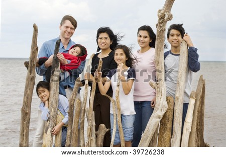 Biracial family together at the beach in summer