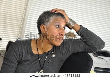 Biracial Professional woman listening - stock photo