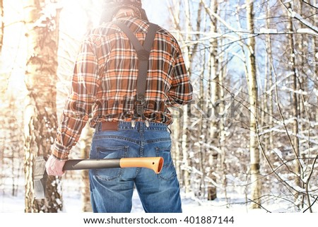 birch winter forest man with axe - stock photo