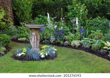 Attractive Bird Bath In A Beautiful Summer Garden.