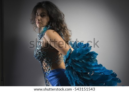 Bird, Brunette woman in costume made of blue feathers, wild and free bird, fantasy image