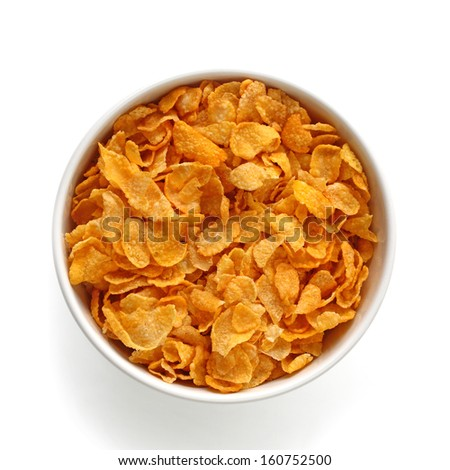 Bird eye view of corn flakes in bowl / Isolated with clipping path on a white background - stock photo