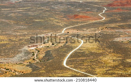Bird eye view on curvy road in the Monument Valley desert - stock photo