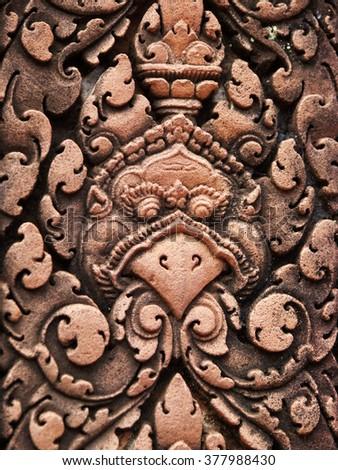 Bird face carving in sandstone, Cambodia - stock photo