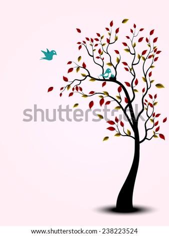Bird family on the tree - stock photo