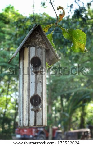 Bird house in the garden - stock photo