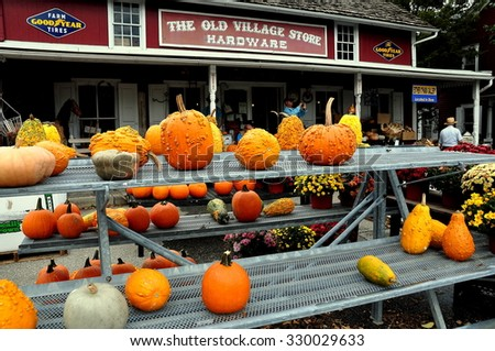 Bird-in-Hand, Pennsylvania - October 14, 2015:  Pumpkins, gourds, and Chrysanthemums are for sale at the Old Village Hardware Store