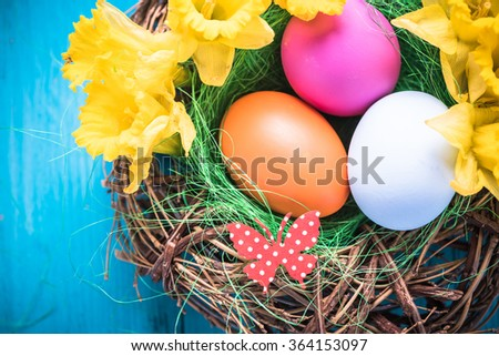 Bird nest with Easter eggs in vibrant pastel colors