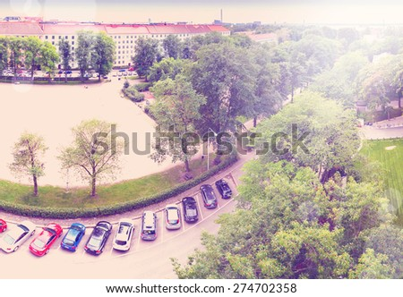Bird perspective view on cars parking on street with instagram effect retro vintage filter - stock photo
