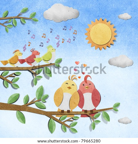 bird recycled paper craft stick on paper background - stock photo