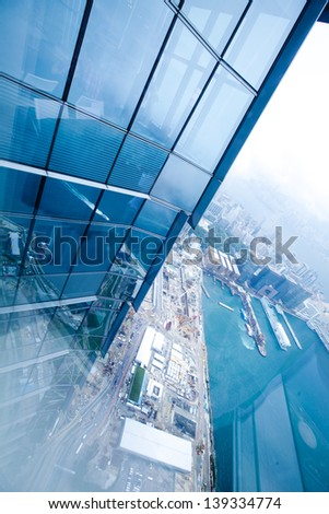 Bird's eye view from modern building in hong kong - stock photo