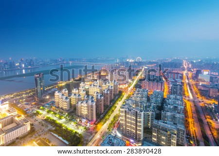 Bird view at Wuhan China. Skyscraper under construction in foreground. Fog, overcast sky and pollution.  - stock photo