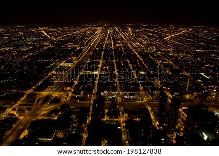 Bird view from Willis (former Sears) Tower at night, overlooking downtown Chicago, Illinois. - stock photo