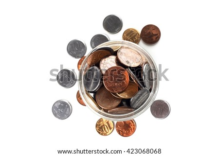 Bird view of a jar full of Brazilian coins isolated on white background - stock photo